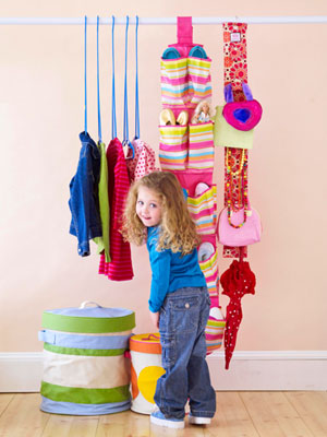 little girl in organized closet