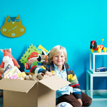 boy with box of toys