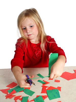 girl cutting construction paper
