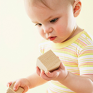 baby playing with wooden blocks