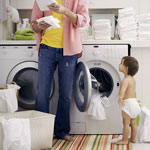 Dad washing and folding cloth diapers