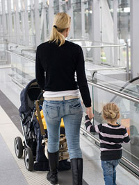 mother with children walking through airport