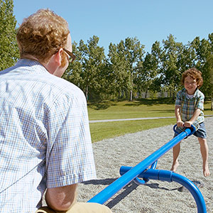 child and father on titter totter