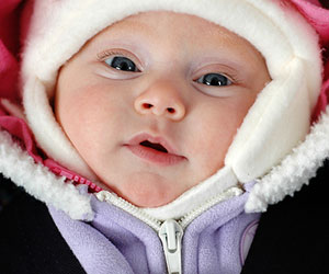 baby dressed in winter clothes