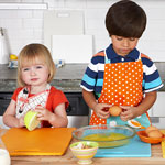 little kids making food