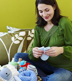 pregnant woman holding baby socks