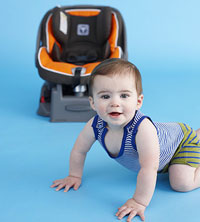 baby crawling next to car seat