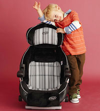 preschooler next to combination car seat