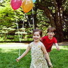 kids holding balloons