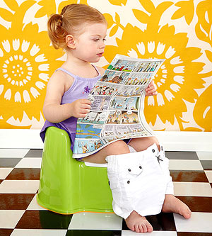 Child on potty reading comic