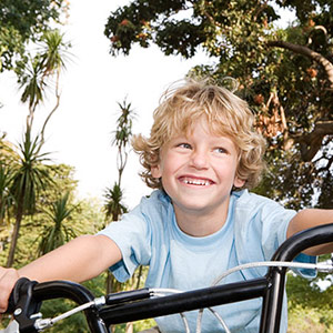 Boy riding his bike