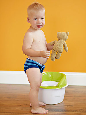 Little Boy with Bear by Training Potty