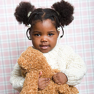 toddler holding teddy bear
