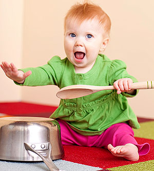 a young child playing with pots and pans