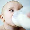 baby drinking bottle of milk