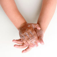 child washing hands