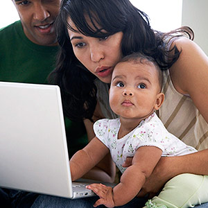 family on laptop computer