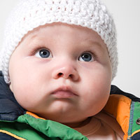 baby wearing hat and coat