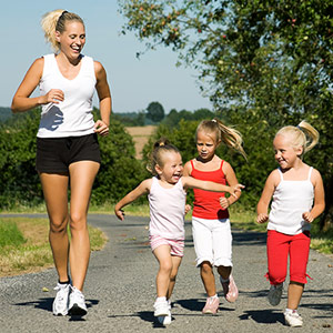 children jogging with mother