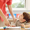 boy in classroom talking to teacher