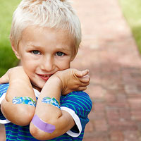 child wearing band-aids
