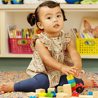 preschooler at school playing with blocks