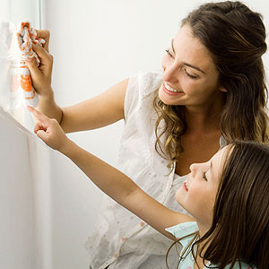 mother teaching daughter to clean