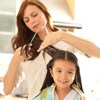 mother cutting child?s hair