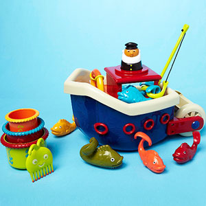 Toy boat, fisherman, and fish