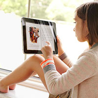 child reading book on ipad