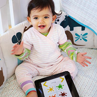 baby playing with ipad