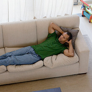 man resting on couch