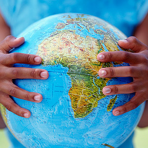 Child holding globe of Earth
