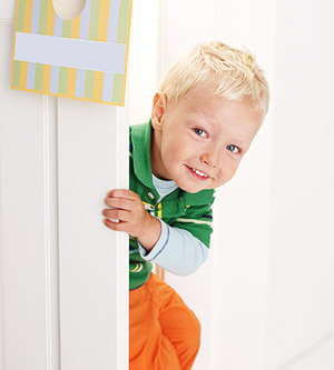 child opening door