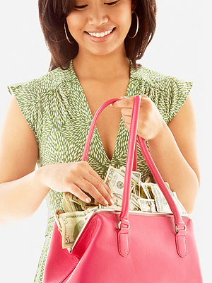 woman holding purse filled with money