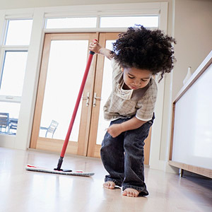 boy cleaning floor