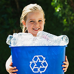 child holding recyclables