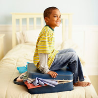 Child sitting on suitcase