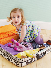 Child sitting in suitcase