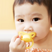 Baby using pacifer