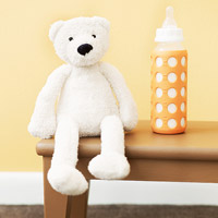 Baby bottle and stuffed animal