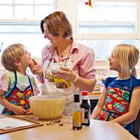 Sally cooks with her kids