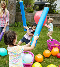 kids playing with pool noodles
