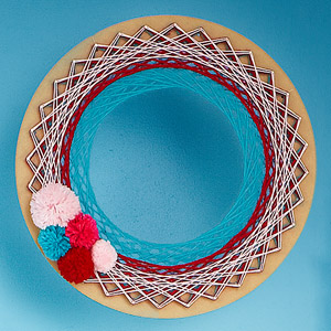Yarn wreath with pom poms