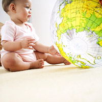 baby looking at globe