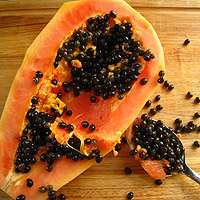 scoop out seeds of papaya