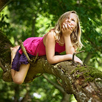 girl climbing tree