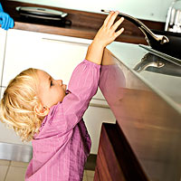 toddler reaching for pan