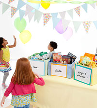 Birthday party with toy bins