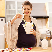 pregnant woman eating take out